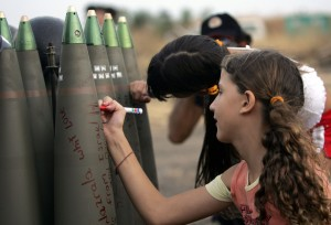 Israeli children signing rockets going into Gaza (c) PressTV